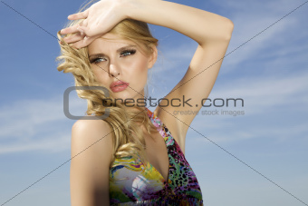 beautiful girl on background blue sky