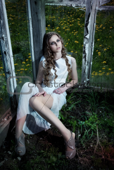 Nature. Flowering garden. Pretty sexy fashion woman sitting