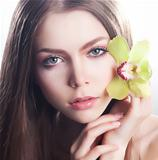 Healthy clean girl face - healthcare and beauty, flower orchid