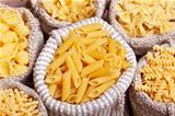 Pasta variety in burlap bags - closeup, top view