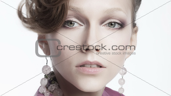 Sexy aristocratic female in earrings - beauty portrait