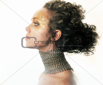 Fashionable woman with luxury golden makeup