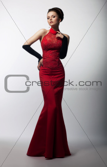 Aristocratic graceful female posing in fashion dress