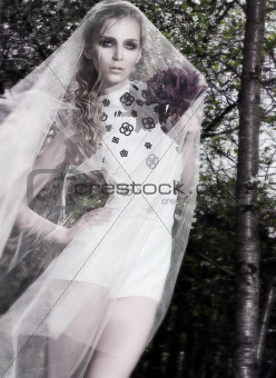 Sensual fiancee in wedding dress posing - nature background