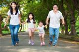 happy asian family walking on the road