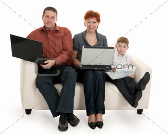 dad, mom and son with laptop