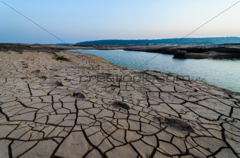cracked soil and pond in Sampanbok ,in Mekong River