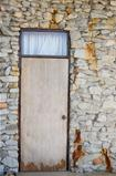 Wood door and stone of wall