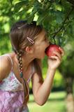 Girl biting into an apple