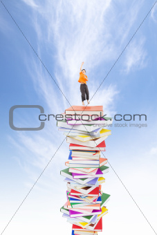 happy kid jumping on the books