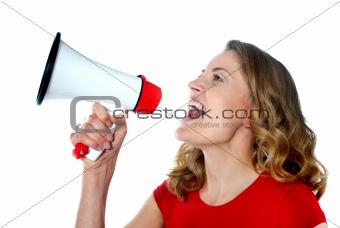 Female spokesperson holding megaphone