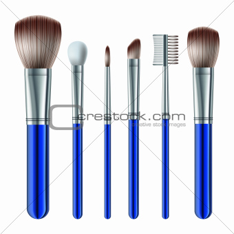 Set of makeup brushes on white background.