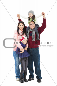 full length of happy asian family in winter clothes standing tog