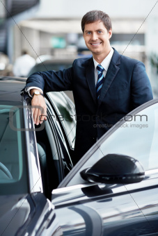 Businessman near cars