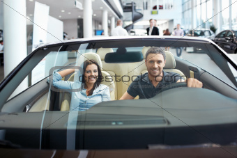 Couple in a cabriolet