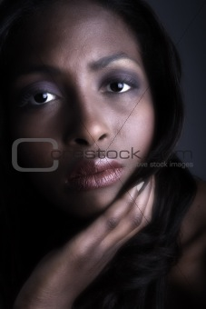 Dark female model looking serious
