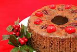 Christmas Fruitcake Closeup on Red