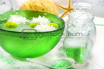 Green bowl with water and flowers