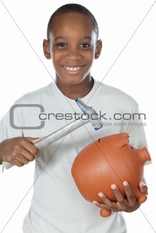 Boy breaking a money box