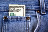 One hundred dollar bill in jeans pocket