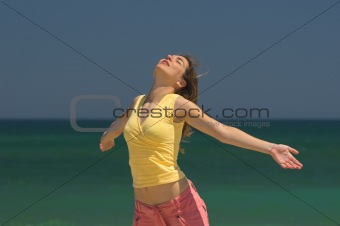 Beautiful woman making poses in the beach