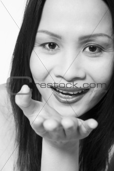 Asian woman blowing you a kiss
