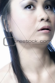 Asian girl looking up