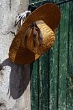 Stylish straw hat on the wall
