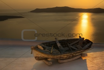 Old boat in sunset