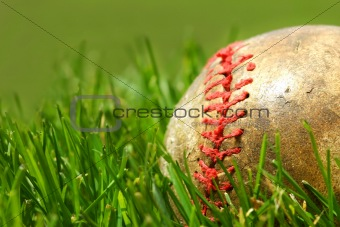Old baseball glove on the grass