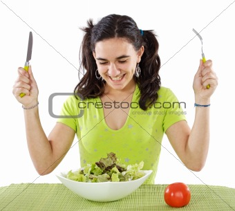 adolescent eating a salad