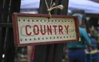 Old sign with stars and the word country