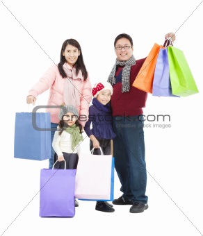 happy asian family with shopping bag in winter clothing