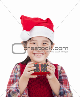 smiling little girl holding christmas gift