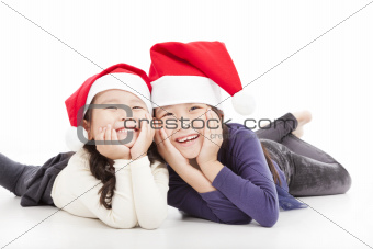 Happy girls in christmas hat isolated on white