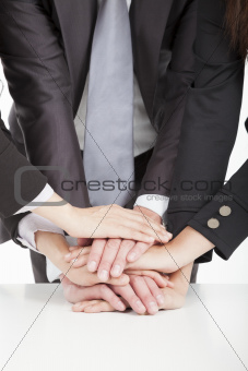 business team with hand together on the table for teamwork conce