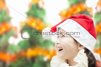 Happy little girl in christmas hat