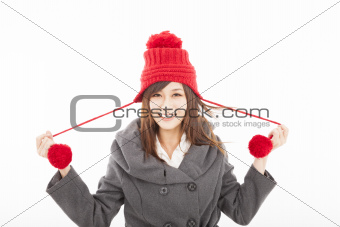 happy young woman wearing winter coat and cap