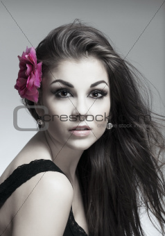 portrait of a young beautiful woman with dark hair looking