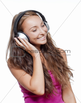 young girl listening to music in earphones smiling - isolated on white