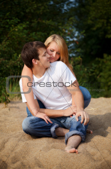 couple sitting on a sand