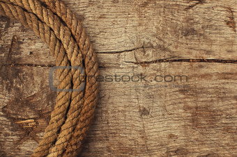 Rope and weathered wood background