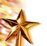 New year golden star in motion on bright bokeh background.jpg