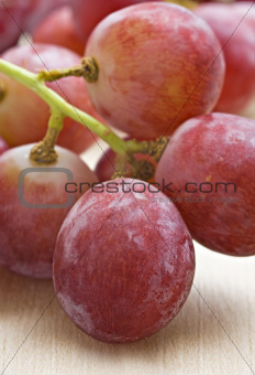 a Bunch of red grapes
