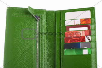 Open green leather wallet with credit cards