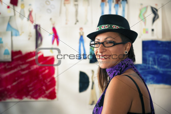 Portrait of happy woman working as fashion designer
