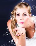 Playful Bride Blowing Bubbles At Wedding Reception