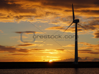 Wind Turbine At Sunrise / Sunset
