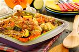 Chicken baked with pumpkin, zucchini, celery and rosemary.