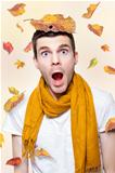 Shocked Man Playing In Falling Autumn Leaves